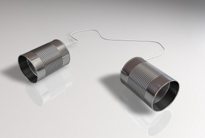 cans linked by string representing communication