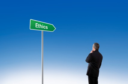"Businessman standing in front of a signpost saying ""Ethics"""